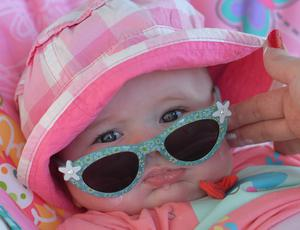 A Young Child Relaxing in the Sunshine on Sunday during the nice weather. Pic: PACEMAKER