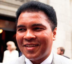 This is a 1995 file photo showing Muhammad Ali smiling during a visit to New York. Ali, the magnificent heavyweight champion whose fast fists and irrepressible personality transcended sports and captivated the world, has died according to a statement released by his family Friday, June 3, 2016. He was 74. (AP Photo/Mark Lennihan, FIle)