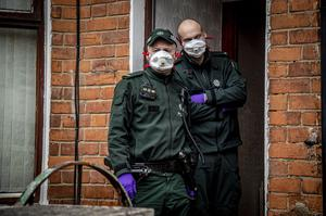 Officers from TSG carry out searches in the north Belfast area during Operation Pangea in March 2020 (Photo by Kevin Scott for Belfast Telegraph)