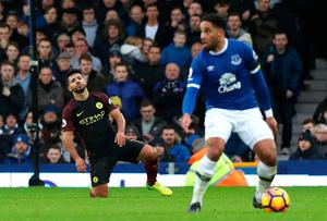 "Manchester City's Sergio Aguero appears dejected during the Premier League match at Goodison Park, Liverpool. PRESS ASSOCIATION Photo. Picture date: Sunday January 15, 2017. See PA story SOCCER Everton. Photo credit should read: Peter Byrne/PA Wire. RESTRICTIONS: EDITORIAL USE ONLY No use with unauthorised audio, video, data, fixture lists, club/league logos or ""live"" services. Online in-match use limited to 75 images, no video emulation. No use in betting, games or single club/league/player publications."