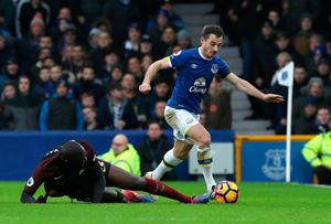"Manchester City's Yaya Toure (left) challenges Everton's Leighton Baines during the Premier League match at Goodison Park, Liverpool. PRESS ASSOCIATION Photo. Picture date: Sunday January 15, 2017. See PA story SOCCER Everton. Photo credit should read: Peter Byrne/PA Wire. RESTRICTIONS: EDITORIAL USE ONLY No use with unauthorised audio, video, data, fixture lists, club/league logos or ""live"" services. Online in-match use limited to 75 images, no video emulation. No use in betting, games or single club/league/player publications."