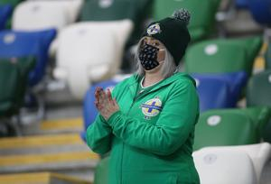 Press Eye-Belfast-Northern Ireland -11th October 2020 National Football Stadium at Windsor Park, Belfast.  11/10/2020 Northern Ireland fans supporting their team against Austria during Sunday night's UEFA Nations League match at the National Football Stadium at Windsor Park,Belfast. Mandatory Credit PressEye