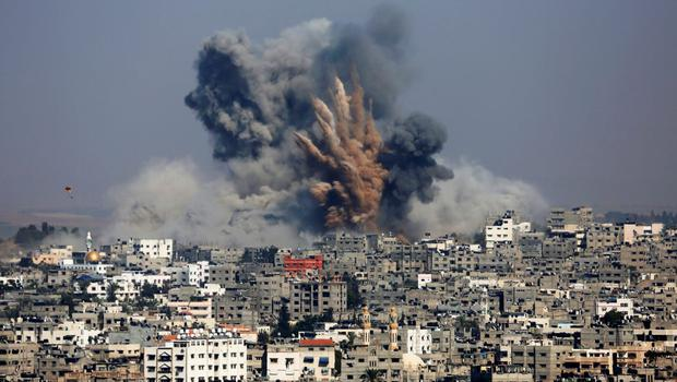 Smoke and fire from the explosion of an Israeli strike rise over Gaza City, Tuesday, July 29, 2014.  (AP Photo/Hatem Moussa)