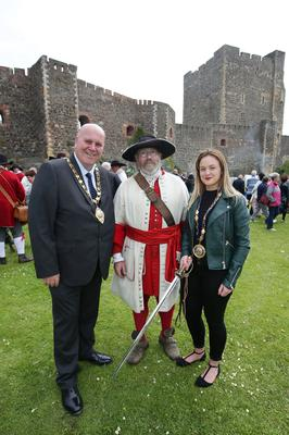 Press Eye - Belfast - Northern Ireland  - 13th July 2017 -   Paul Reid, Mayor of Mid and East Antrim and  Deputy Mayor Cheryl Johnston, with Boyd Rankin who took part of  the re-enactment of the Siege of Carrickfergus Castle and the landing of King William at Castle Green, Carrickfergus. The event included re-enactment groups from across the Northern Oteland, all dressed in period costume followed by a Pageantry parade to meet King William upon his landing at Carrick Harbour.   Photo by Kelvin Boyes / Press Eye.