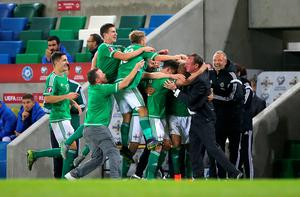 Northern Ireland's Josh Magennis celebrates scoring his side's second goal of the match with teammates during the UEFA European Championship Qualifying match at Windsor Park, Belfast. PRESS ASSOCIATION Photo. Picture date: Thursday October 8, 2015. See PA story SOCCER N Ireland. Photo credit should read: Niall Carson/PA Wire.