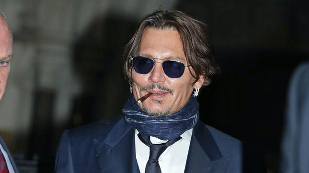Actor Johnny Depp leaving the High Court in London after attending a hearing in his libel case against the publishers of The Sun and its executive editor, Dan Wootton (Yui Mok/PA)