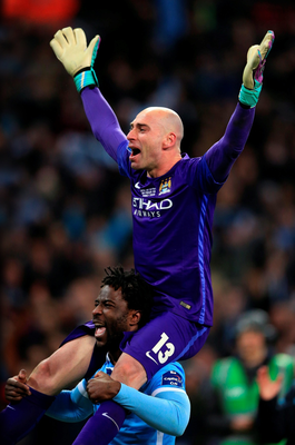 Centre stage: Willy Caballero is given a lift by Wilfried Bony after his spot-kick heroics