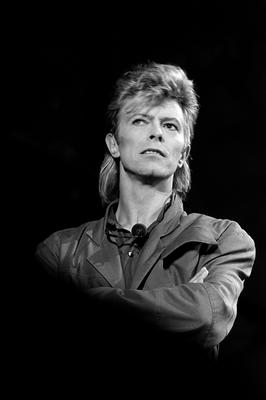 """(FILES) This file photo taken on July 03, 1987 shows British singer David Bowie performing on stage during a concert in La Courneuve on July 3, 1987.   British rock music legend David Bowie has died after a long battle with cancer, his official Twitter and Facebook accounts said on January 11, 2016. Bowie died on Januray 10 surrounded by family according to his social media accounts. The iconic musician had turned 69 only on January 8, which coincided with the release of """"Blackstar"""", his 25th studio album. / AFP / BERTRAND GUAYBERTRAND GUAY/AFP/Getty Images"""