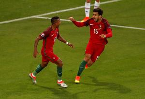 Portugal's Nani, left, celebrates scoring the opening goal with team mate Andre Gomes during the Euro 2016 Group F soccer match between Portugal and Iceland at the Geoffroy Guichard stadium in Saint-Etienne, France, Tuesday, June 14, 2016. (AP Photo/Michael Sohn)