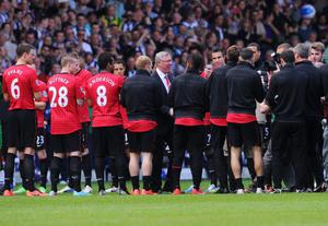 WEST BROMWICH, ENGLAND - MAY 19:  Manchester United manager Sir Alex Ferguson is given a 'guard of honour' prior his 1,500th and final match in charge of the club ahead of the Barclays Premier League match between West Bromwich Albion and Manchester United at The Hawthorns on May 19, 2013 in West Bromwich, England.  (Photo by Michael Regan/Getty Images)