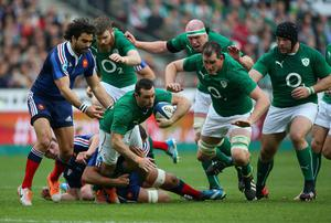 Dave Kearney of Ireland is tackled during the RBS Six Nations match between France and Ireland at Stade de France on March 15, 2014 in Paris, France.  (Photo by Julian Finney/Getty Images)