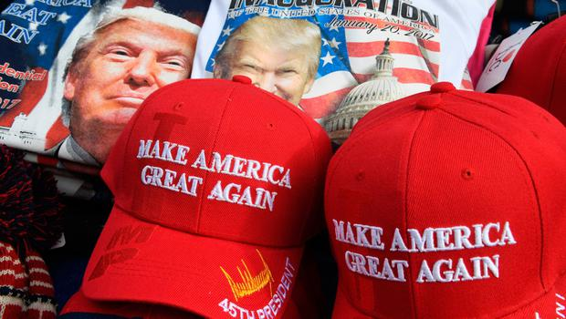 US President-elect Donald Trump merchandise on sale outside the White House in Washington, DC, on January 19, 2017, as final preparations are underway a day ahead of the inauguration of the 45th US president. / AFP PHOTO / Mark RALSTONMARK RALSTON/AFP/Getty Images