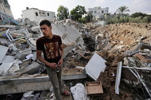 A Palestinian stands on the rubble of what used to be the house belonging to Muhammed Jmasy family. Thursday, July 31, 2014. (AP Photo/Lefteris Pitarakis)