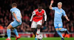 Front foot: Arsenal ace Nicolas Pepe on the attack against Leeds