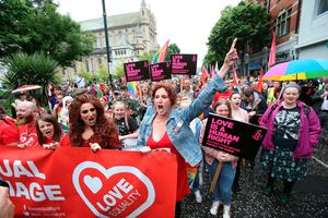 Hollyoaks actress Bronagh Waugh (centre) raises her arm as she joins campaigners calling for the introduction of same sex marriage in Northern Ireland gather in front of St Anne's Cathedral before they staged a parade and rally in Belfast City centre. PRESS ASSOCIATION Photo. Picture date: Saturday July 1, 2017. See PA story ULSTER Marriage. Photo credit should read: Niall Carson/PA Wire