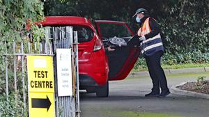 A motorist is handed a test kit at Castleknock Health Centre (Niall Carson/PA)