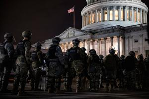 WASHINGTON, DC - JANUARY 06: Members of the National Guard and the Washington D.C. police stand guard to keep demonstrators away from the U.S. Capitol on January 06, 2021 in Washington, DC. A pro-Trump mob stormed the Capitol earlier, breaking windows and clashing with police officers. Trump supporters gathered in the nation's capital to protest the ratification of President-elect Joe Biden's Electoral College victory over President Donald Trump in the 2020 election. (Photo by Samuel Corum/Getty Images)