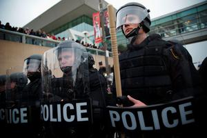 BALTIMORE, MD - APRIL 25:  Police in riot gear block a street during a march in honor of Freddie Gray on April 25, 2015 in Baltimore, Maryland. Gray, 25, was arrested for possessing a switch blade knife outside the Gilmor Homes housing project on Baltimore's west side on April 12. According to his attorney, Gray died a week later in the hospital from a severe spinal cord injury he received while in police custody.  (Photo by Alex Wong/Getty Images)