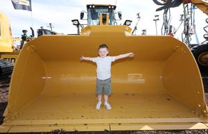 PressEye-Northern Ireland- 15th May  2019-Picture by Brian Little/PressEye  Kieran Loughran aged 4 from Dungannon in the shovel of a CAT Wheel Loader , 18,849 kg,  at Balmoral Park during the first day of the Balmoral Show 2019 Picture by Brian Little/PressEye