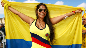 BELO HORIZONTE, BRAZIL - JUNE 14:  A Colombia fan holds a flag prior to the 2014 FIFA World Cup Brazil Group C match between Colombia and Greece at Estadio Mineirao on June 14, 2014 in Belo Horizonte, Brazil.  (Photo by Ian Walton/Getty Images)