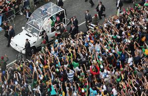 RIO DE JANEIRO, BRAZIL - JULY 28: Pope Francis waves from the Popemobile as he arrives to celebrate Mass on Copacabana Beach during World Youth Day celebrations on July 28, 2013 in Rio de Janeiro, Brazil. More than 1.5 million pilgrims are expected to join the pontiff for his visit to the Catholic Church's World Youth Day celebrations which is running July 23-28.  (Photo by Mario Tama/Getty Images)
