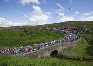 Tour de France riders cross the bridge in 2014 (Tim Goode/PA)