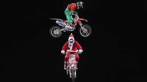 Northern Ireland- 9th December 2013 Mandatory Credit - Photo-Jonathan Porter/Presseye.  Arenacross Freestyle Motocross riders Dan Whitby, Samson Eaton and Arran Powley dropped in to the Belfast Odyssey Arena on Wednesday dressed as Santa and his two elves and will be soaring across the Arena to pre-promote the up-coming Arenacross series which kicks off with a double-header at the Odyssey Arena, Belfast, on January 17/18.