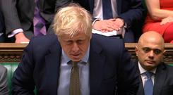Prime Minister Boris Johnson speaks during Prime Minister's Questions in the House of Commons. House of Commons/PA Wire