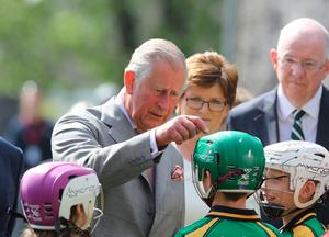 The Prince of Wales talks to children at  Kilkenny Castle after he watched a hurling demonstration before touring some of the castle and attending a civic reception. PA
