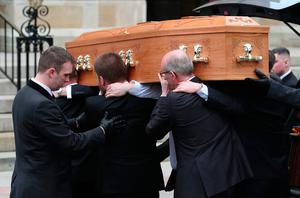 The coffin is carried into the funeral service of murdered journalist Lyra McKee at St Anne's Cathedral in Belfast.