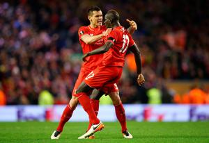 LIVERPOOL, ENGLAND - APRIL 14: Mamadou Sakho of Liverpool celebrates scoring his team's third goal with Dejan Lovren during the UEFA Europa League quarter final, second leg match between Liverpool and Borussia Dortmund at Anfield on April 14, 2016 in Liverpool, United Kingdom. (Photo by Clive Brunskill/Getty Images)