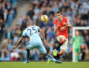 Manchester United's Angel Di Maria and Manchester City's Fernandinho battle for the ball during the Barclays Premier League match at the Etihad Stadium, Manchester. Martin Rickett/PA Wire.
