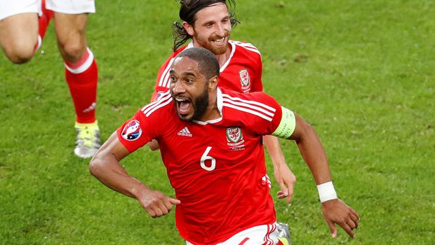Wales' Ashley Williams, foreground, celebrates  scoring an equalizer during the Euro 2016 quarterfinal soccer match between Wales and Belgium, at the Pierre Mauroy stadium in Villeneuve dAscq, near Lille, France, Friday, July 1, 2016. (AP Photo/Michael Sohn)