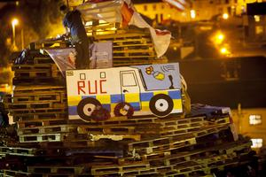 The two poppy wreaths pictured on the Bogside bonfire in Derry