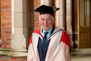 Sir Malcolm McKibbin, former Head of the Northern Ireland Civil Service, received his honorary degree from Queen's University Belfast for distinction in public service.