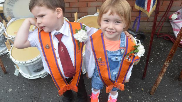 PACEMAKER BELFAST  13/07/2015 Sibblings Madison and  Carson McAllister during  The 12th of July Parades Belfast City on Monday  to commemorate protestant King William of Orange's victory over Catholic King James II at the Battle of the Boyne in 1690. Photo Colm Lenaghan/Pacemaker Press