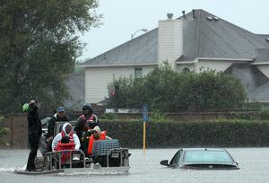 HOUSTON, TX - AUGUST 28:  Residents  are evacuated from their homes after severe flooding following Hurricane Harvey in the Cypresswood Creek subdivision in north Houston August 28, 2017 in Houston, Texas. Harvey, which made landfall north of Corpus Christi late Friday evening, is expected to dump upwards of 40 inches of rain over the next couple of days.  (Photo by Win McNamee/Getty Images) *** BESTPIX ***