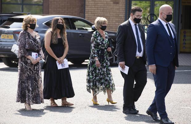 19th July 2021  Pastors of Whitewell Tabernacle carry the coffin of Pastor mcConnell from the church followed by family members.Pastor Daughters Linda and Julie with grand daughter Rebecca Photo : Stephen Hamilton/Presseye
