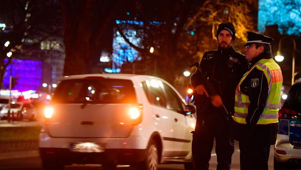 Police blocks a road leading to a scene where a truck speeded into a christmas market in Berlin, on December 19, 2016 killing at least one person and injuring at least 50 people. / AFP PHOTO / John MACDOUGALLJOHN MACDOUGALL/AFP/Getty Images