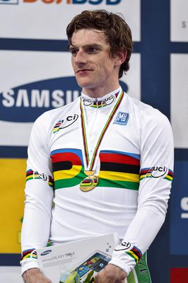 Martyn Irvine on the podium after winning gold