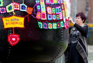 Friday 19th September 2014, Belfast, Northern Ireland - BELFAST TELEGRAPH - Preparations underway in Belfast for Culture Night  Pictured is volunteers yarn bombing buoy's in Bouy Park located outside the University of Ulster Belfast  Picture Credit : Kevin Scott / Belfast Telegraph