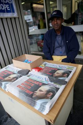 PRETORIA, SOUTH AFRICA - MARCH 03:  A newspaper vendor sells the Pretoria News as the Oscar Pistorius trail starts at North Gauteng High Court on March 3, 2014 in Pretoria, South Africa.  Olympic and Paralympic athlete Oscar Pistorius, aged 27, is accused of murdering his girlfriend Reeva Steenkamp. Pistorius denies the allegation claiming he mistook Steenkamp for an intruder inside their home on Valentines Day 2013.  (Photo by Christopher Furlong/Getty Images)