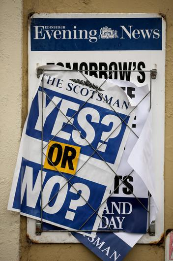 EDINBURGH, SCOTLAND - SEPTEMBER 18: Newspaperflyers pose the 'Yes or No' question during the Scottish referendum on September 18, 2014 in Edinburgh, Scotland. After many months of campaigning the people of Scotland today head to the polls to decide the fate of their country.  The referendum is too close to call but a 'Yes' vote would see the break-up of the United Kingdom and Scotland would stand as an independent country for the first time since the formation of the Union.  (Photo by Christopher Furlong/Getty Images)