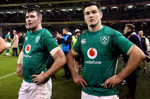 Ireland's Peter O'Mahony, left, and captain Johnny Sexton, right, this week signed contract extensions (Brian Lawless/PA)