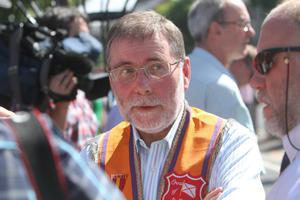 Sunday Life News  Nelson McCausland with the  Orange Order hold a protest on the Woodvale Road North Belfast a week on from the 12th of July. Ligoniel Orange Lodge was refused by the parades commission their return parade from the 12th of July demonstratiuons in Belfast City Centre.  Picture Colm O'Reilly 20-07-2013 Sunday Life