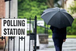 A voter arrives at the polling station in St Nicolas Parish Hall, Belfast, as voting gets underway in the 2017 General Election. Pic: Liam McBurney/PA Wire