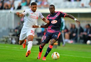 Bordeaux's French defender Maxime Poundje (R) vies with Liverpool's forward Jordon Ibe (L) during the UEFA Europa League Group B football match Bordeaux vs Liverpool on September 17, 2015 at the Matmut Atlantique stadium in Bordeaux. AFP PHOTO / NICOLAS TUCATNICOLAS TUCAT/AFP/Getty Images