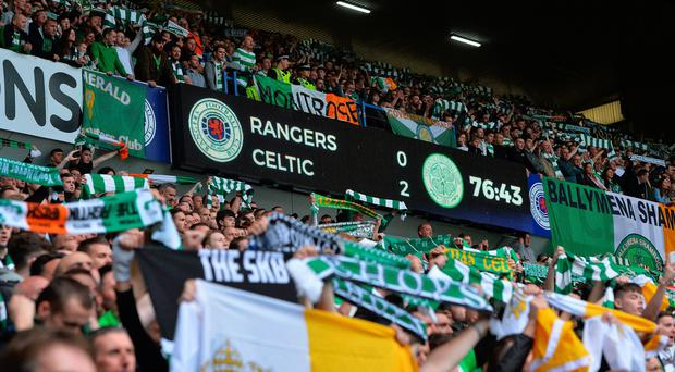 Holding firm: Celtic fans have enjoyed success over Rangers at Ibrox in recent Old Firm clashes