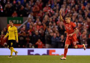 Liverpool's Brazilian midfielder Philippe Coutinho (R) celebrates after scoring during the UEFA Europa league quarter-final second leg football match between Liverpool  and Borussia Dortmund at Anfield stadium in Liverpool on April 14, 2016. / AFP PHOTO / OLI SCARFFOLI SCARFF/AFP/Getty Images
