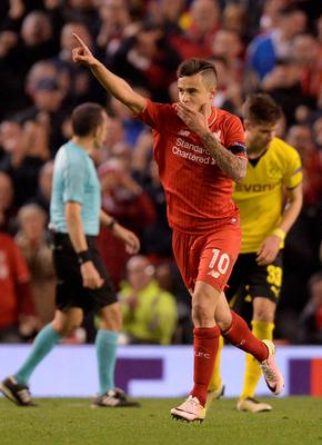 Liverpool's Brazilian midfielder Philippe Coutinho celebrates after scoring during the UEFA Europa league quarter-final second leg football match between Liverpool  and Borussia Dortmund at Anfield stadium in Liverpool on April 14, 2016. / AFP PHOTO / OLI SCARFFOLI SCARFF/AFP/Getty Images
